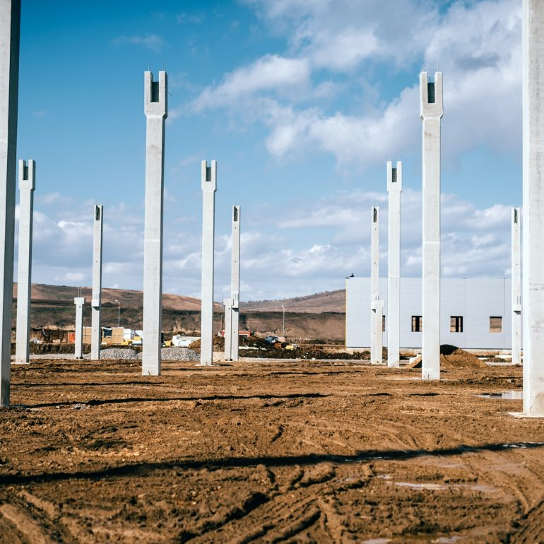 Installation and assembly of concrete precast pillars on construction site